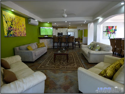 Living room area with 4 white sofas